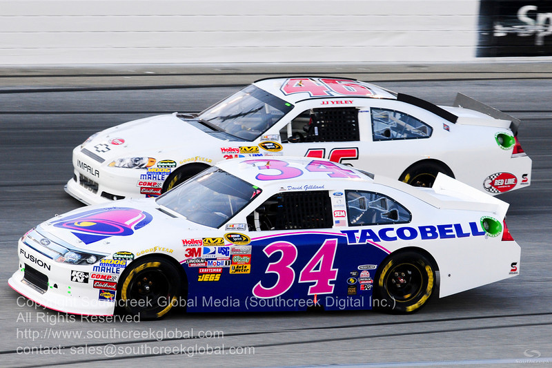 Front Row Motorsports driver David Gilliland (34) in the Taco Bell Ford during the NASCAR Inaugural Quaker State 400 at the Kentucky Speedway Sparta,Kentucky.