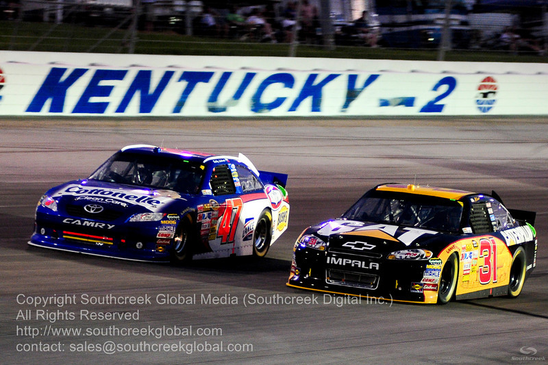 JTG Daugherty Racing driver Bobby Labonte (47) in the Scott Products Toyota and Richard Childress Racing driver Jeff Burton (31)in the Caterpiller Chevrolet during the NASCAR Inaugural Quaker State 400 at the Kentucky Speedway Sparta,Kentucky.