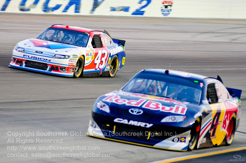 Richard Petty Motorsports driver Marcos Ambrose (9) in the Porter-Cable Power Ford and Richard Petty Motorsports driver A.J. Allmendinger (43) in the Valvoline Ford during the NASCAR Inaugural Quaker State 400 at the Kentucky Speedway Sparta,Kentucky.