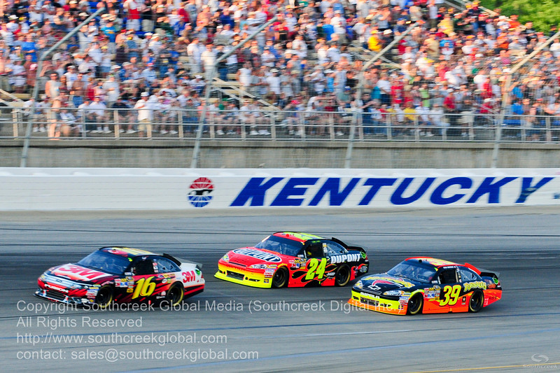 Hendrick Motorsports driver Jeff Gordon (24) in the DuPont Chevrolet during the NASCAR Inaugural Quaker State 400 at the Kentucky Speedway Sparta,Kentucky.