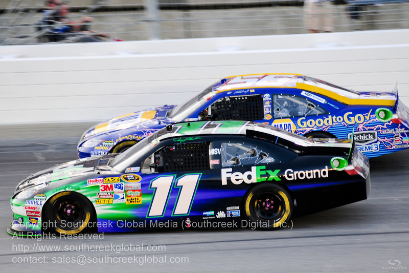 Joe Gibbs Racing driver Denny Hamlin (11) in the FedEx Ground Toyota during the NASCAR Inaugural Quaker State 400 at the Kentucky Speedway Sparta,Kentucky.