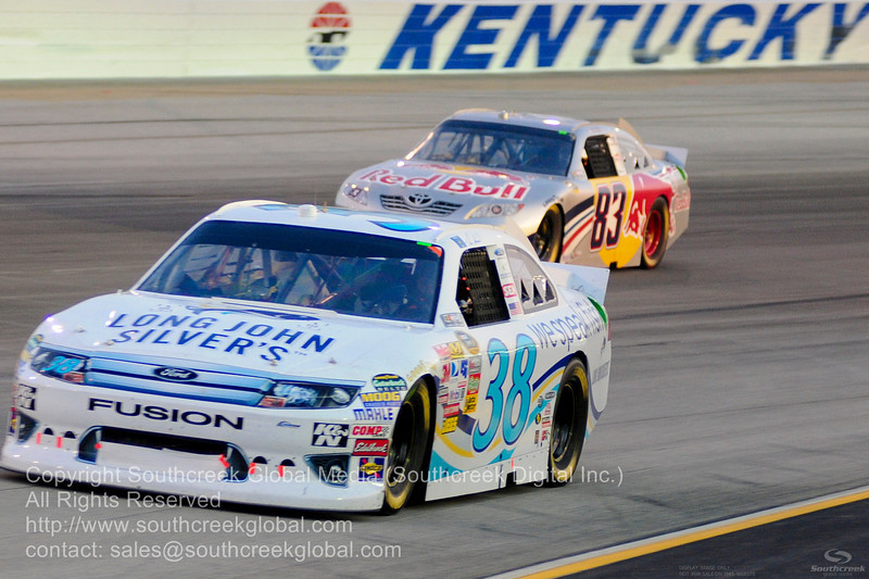 Front Row Motorsports driver Travis Kvapil (38) in the Long John Silver Ford during the NASCAR Inaugural Quaker State 400 at the Kentucky Speedway Sparta,Kentucky.