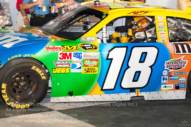 Joe Gibbs Racing driver Kyle Busch (18) in the M&M's Toyota after winning the NASCAR Inaugural Quaker State 400 at the Kentucky Speedway Sparta,Kentucky.