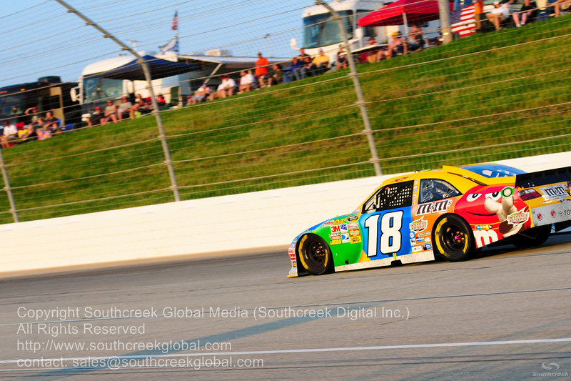 Joe Gibbs Racing driver Kyle Busch (18) in the M&M's Toyota  during the NASCAR Inaugural Quaker State 400 at the Kentucky Speedway Sparta,Kentucky.