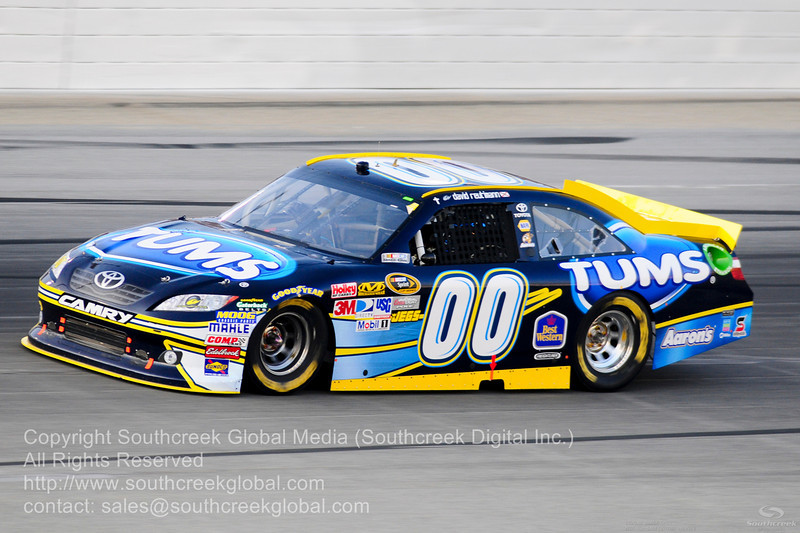 Michael Waltrip Racing driver David Reutimann (00) in the Tums Toyota during the NASCAR Inaugural Quaker State 400 at the Kentucky Speedway Sparta,Kentucky.