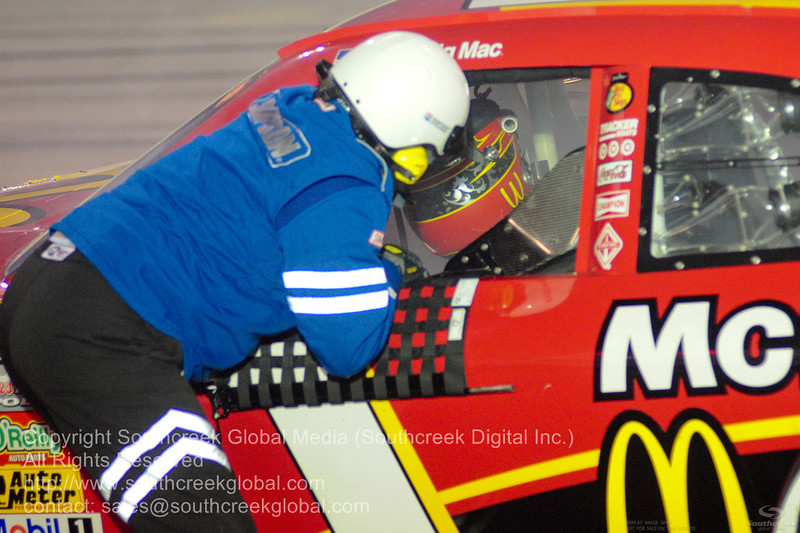 Earnhardt Ganassi Racing driver Jamie McMurray (1) in the McDonalds Chevrolet car gets help from a safety member  after blowing the engine during the NASCAR Inaugural Quaker State 400 at the Kentucky Speedway Sparta,Kentucky.