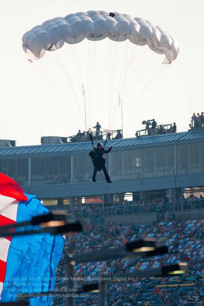 Parachutes bring the American flag before the NASCAR Inaugural Quaker State 400 at the Kentucky Speedway Sparta,Kentucky.