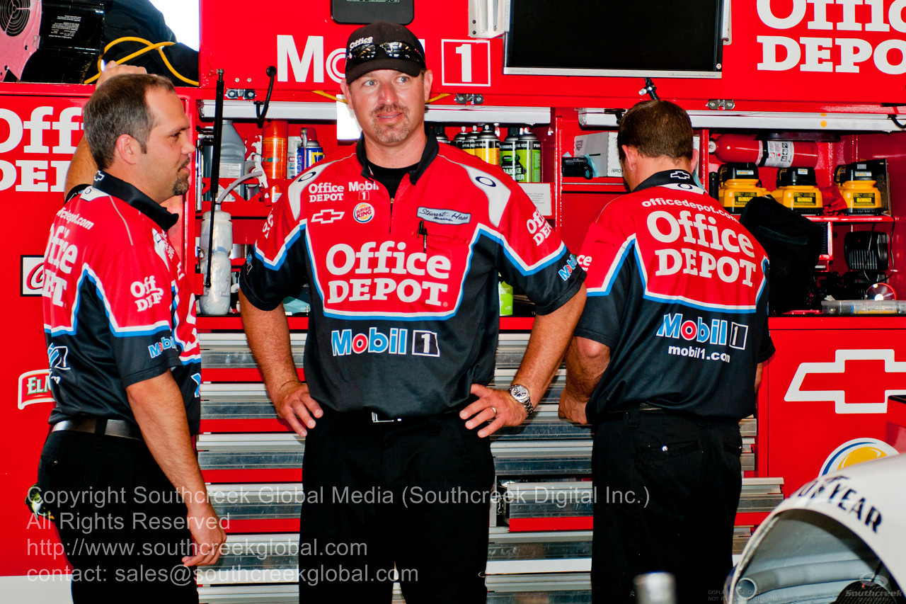 Stewart-Haas Racing crew (14) in the Office Depot/Moble1 Chevrolet garage before the NASCAR Inaugural Quaker State 400 at the Kentucky Speedway Sparta,Kentucky.