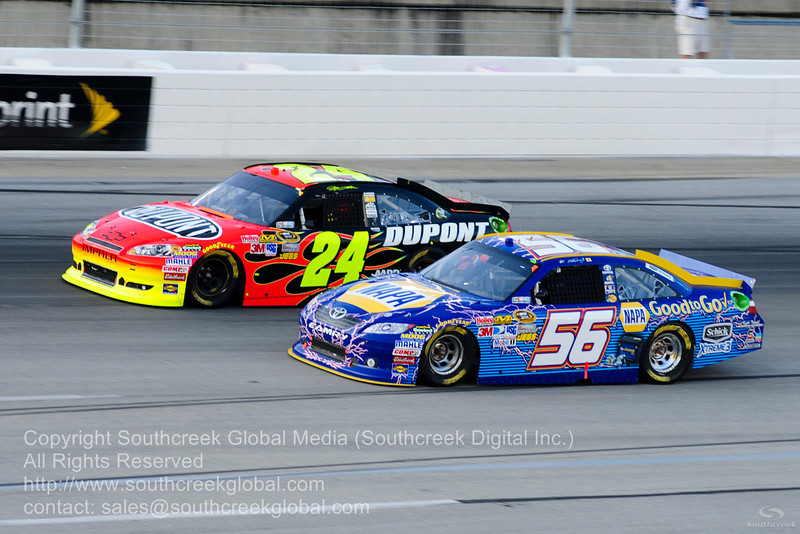 """Michael Waltrip Racing driver Martin Truex Jr. (56) in the NAPA """"Good To Go"""" Toyota and Hendrick Motorsports driver Jeff Gordon (24) in the DuPont Chevrolet during the NASCAR Inaugural Quaker State 400 at the Kentucky Speedway Sparta,Kentucky."""