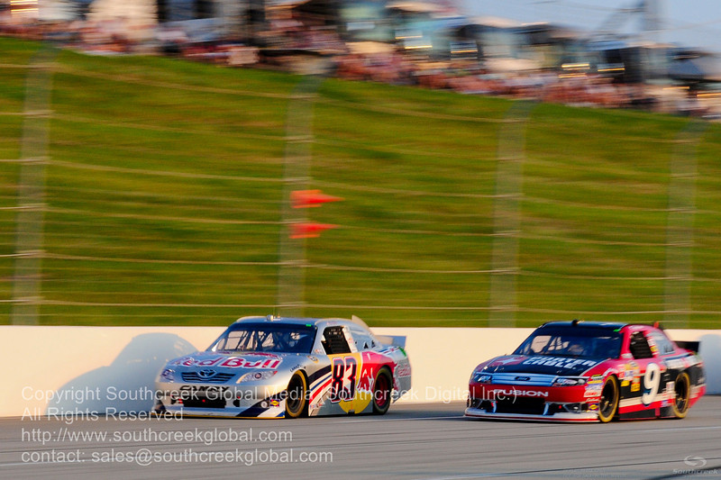 Red Bull Racing Team driver Brian Vickers (83) in the Red Bull Toyota and Richard Petty Motorsports driver Marcos Ambrose (9) in the Porter-Cable Power Ford during the NASCAR Inaugural Quaker State 400 at the Kentucky Speedway Sparta,Kentucky.