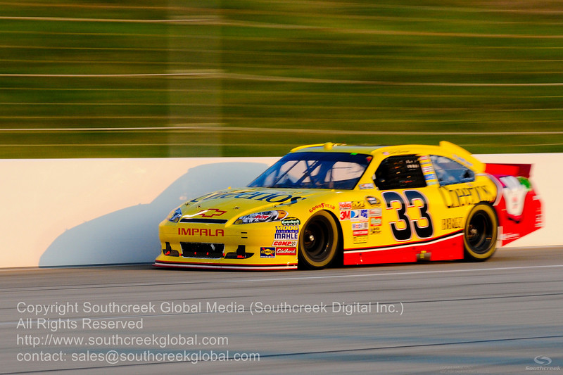 Richard Childress Racing driver Clint Bowyer (33) in the Cheerios/Hamburger Helper Chevrolet during the NASCAR Inaugural Quaker State 400 at the Kentucky Speedway Sparta,Kentucky.