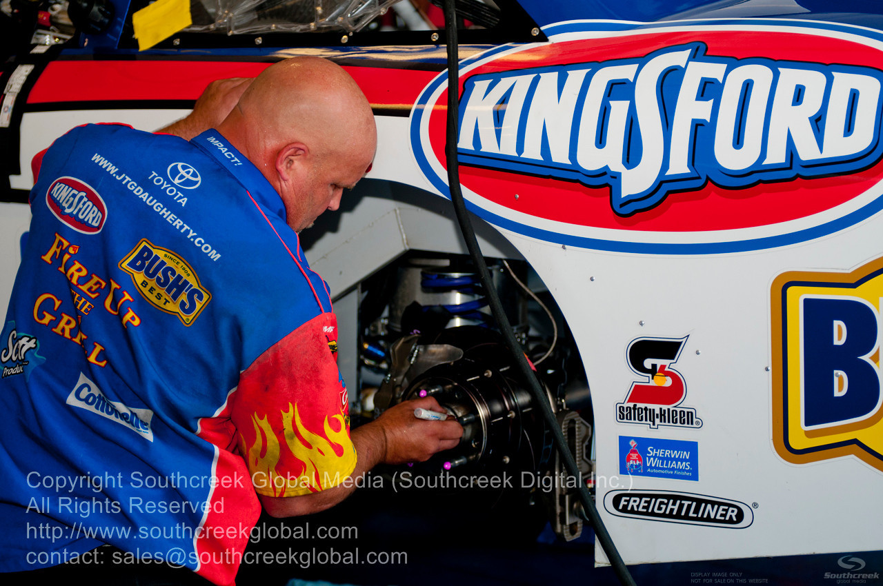 JTG Daugherty Racing crew member (47) in the Scott Products Toyota garage before the NASCAR Inaugural Quaker State 400 at the Kentucky Speedway Sparta,Kentucky.
