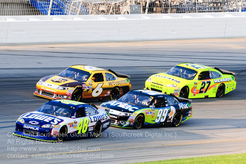 Hendrick Motorsports driver Jimmie Johnson (48) in the Lowes Chevrolet and Roush Fenway Racing driver Carl Edwards (99) in the Aflac Ford during the NASCAR Inaugural Quaker State 400 at the Kentucky Speedway Sparta,Kentucky.