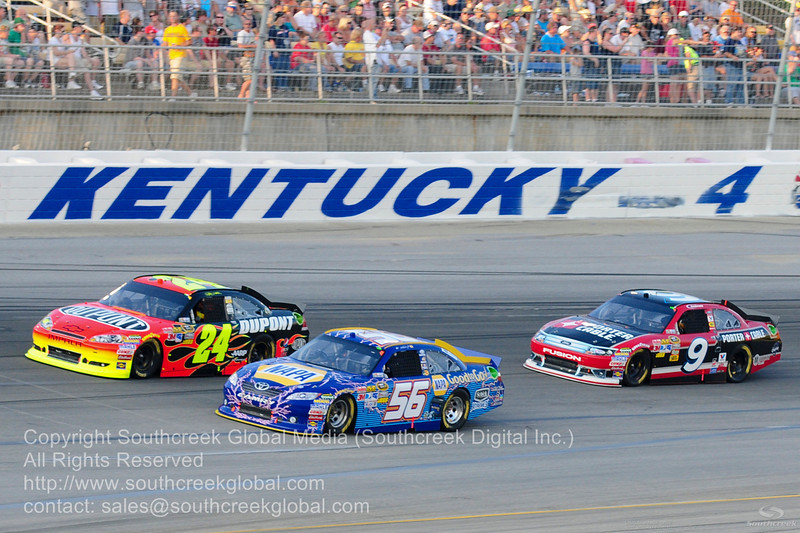 """Michael Waltrip Racing driver Martin Truex Jr. (56) in the NAPA """"Good To Go"""" Toyota and Hendrick Motorsports driver Jeff Gordon (24) in the DuPont Chevrolet with Richard Petty Motorsports driver Marcos Ambrose (9) in the Porter-Cable Power Ford during the NASCAR Inaugural Quaker State 400 at the Kentucky Speedway Sparta,Kentucky."""