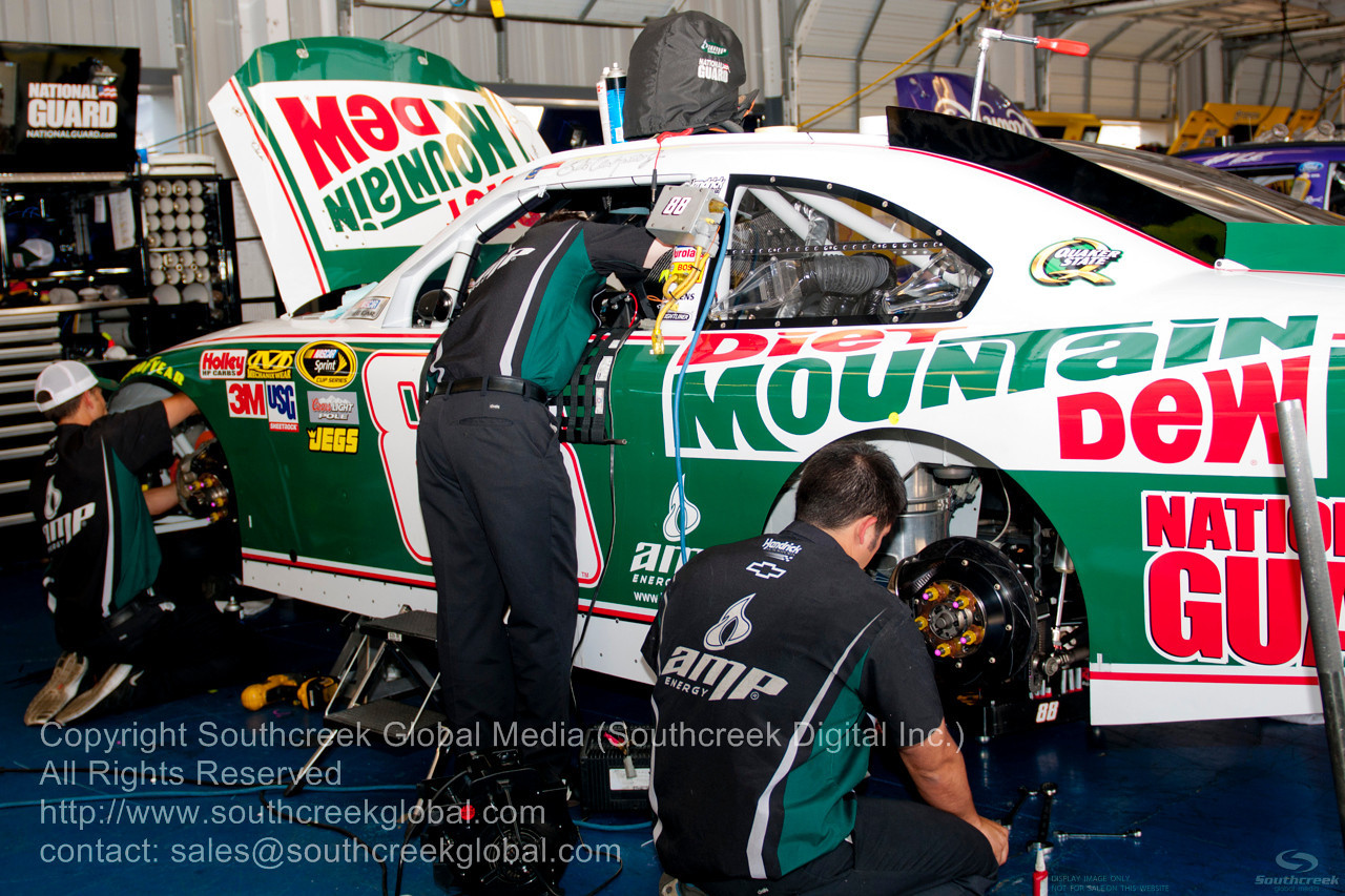 Hendrick Motorsports (88) in the Diet Mountain Dew Chevrolet garage before the NASCAR Inaugural Quaker State 400 at the Kentucky Speedway Sparta,Kentucky.