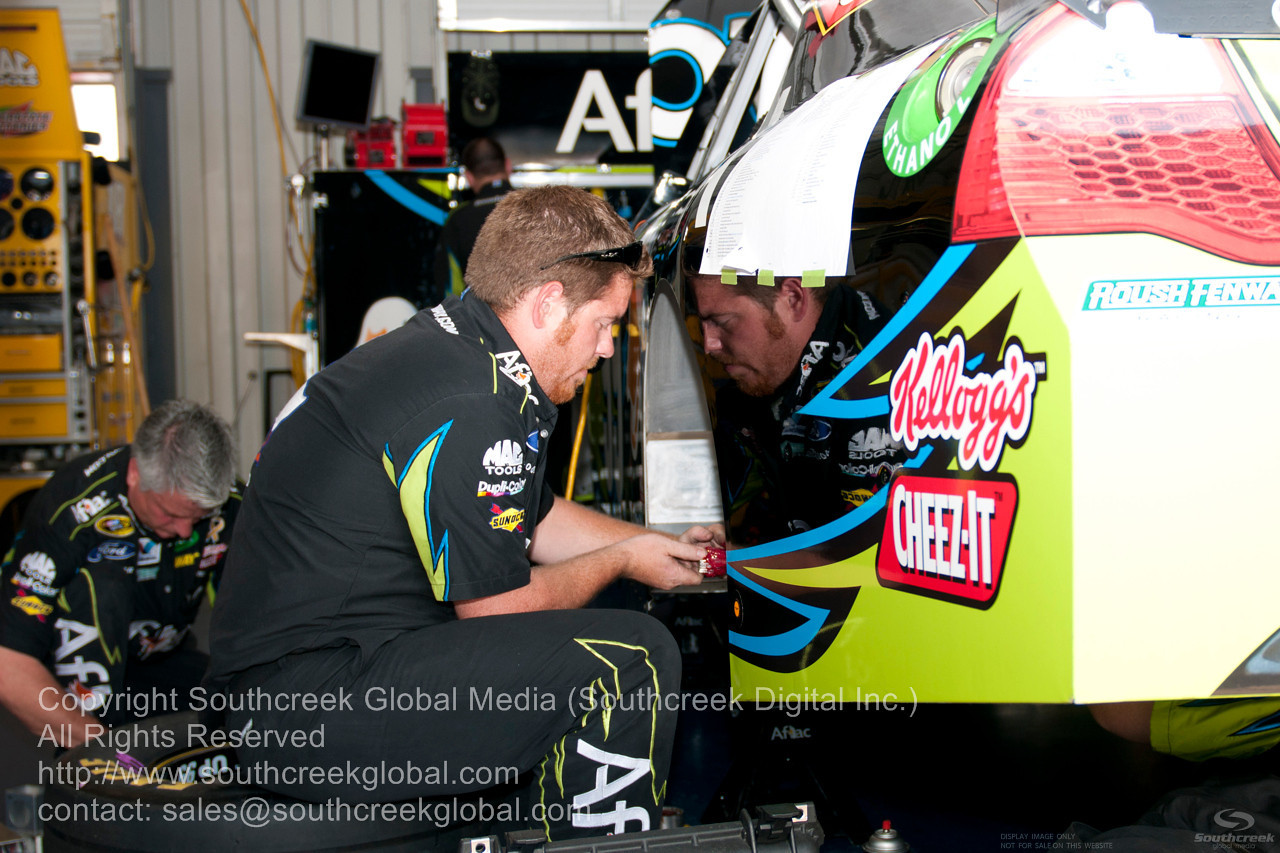 Roush Fenway Racing crew (99) in the Aflac Ford garage before the NASCAR Inaugural Quaker State 400 at the Kentucky Speedway Sparta,Kentucky.