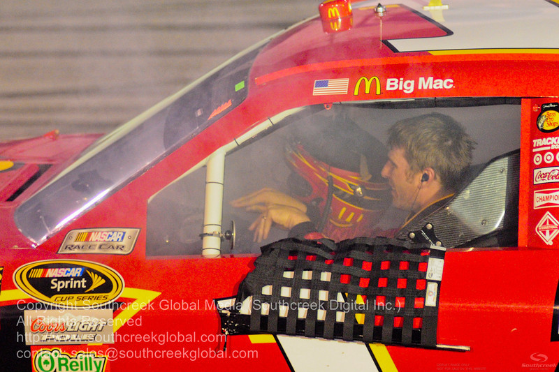 Earnhardt Ganassi Racing driver Jamie McMurray (1) in the McDonalds Chevrolet car fills with smoke after blowing the engine during the NASCAR Inaugural Quaker State 400 at the Kentucky Speedway Sparta,Kentucky.
