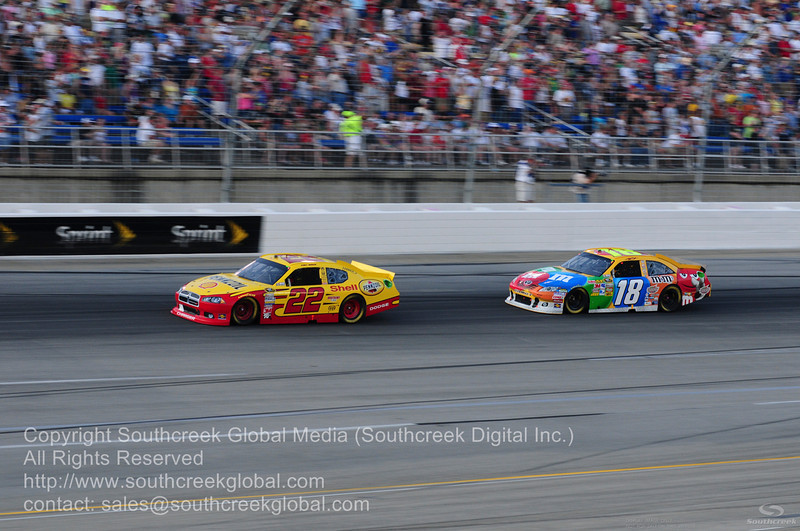 Joe Gibbs Racing driver Kyle Busch (18) in the M&M's Toyota and Penske Racing driver Kurt Busch (22) in the Shell/Pennzoil Dodge during the NASCAR Inaugural Quaker State 400 at the Kentucky Speedway Sparta,Kentucky.