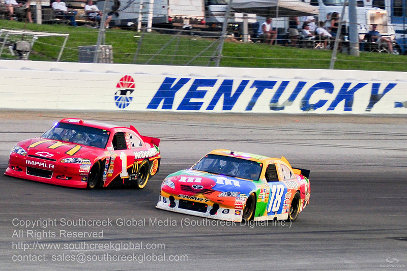 Joe Gibbs Racing driver Kyle Busch (18) in the M&M's Toyota and Earnhardt Ganassi Racing driver Jamie McMurray (1) in the McDonalds Chevrolet during the NASCAR Inaugural Quaker State 400 at the Kentucky Speedway Sparta,Kentucky.