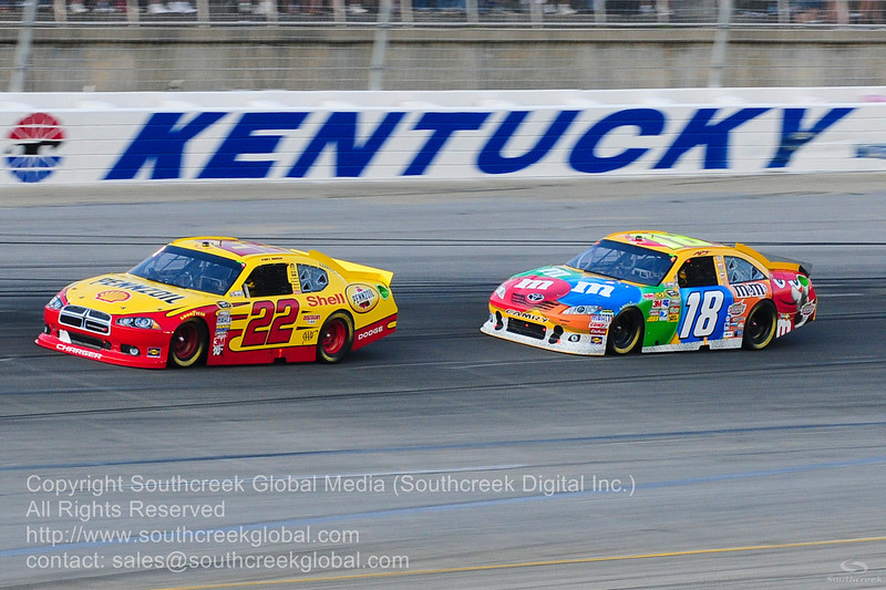 Penske Racing driver Kurt Busch (22) in the Shell/Pennzoil Dodge and Joe Gibbs Racing driver Kyle Busch (18) in the M&M's Toyota during the NASCAR Inaugural Quaker State 400 at the Kentucky Speedway Sparta,Kentucky.
