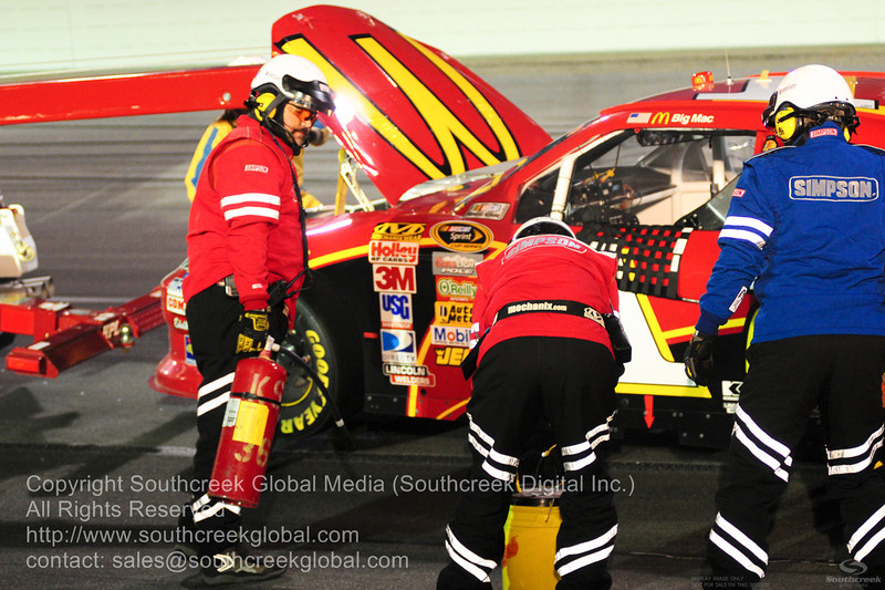 Earnhardt Ganassi Racing driver Jamie McMurray (1) in the McDonalds Chevrolet gets towed after blowing his engine during the NASCAR Inaugural Quaker State 400 at the Kentucky Speedway Sparta,Kentucky.
