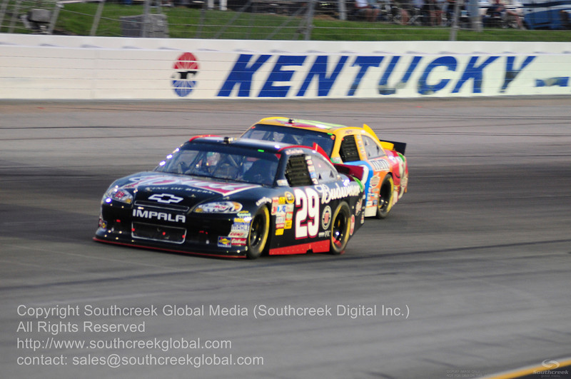 Richard Childress Racing driver Kevin Harvick (29) in the Budweiser Chevrolet during the NASCAR Inaugural Quaker State 400 at the Kentucky Speedway Sparta,Kentucky.