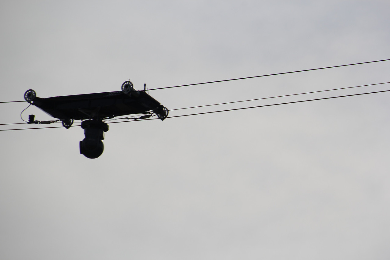 the aerial camera hangs under the fast moving carriage.