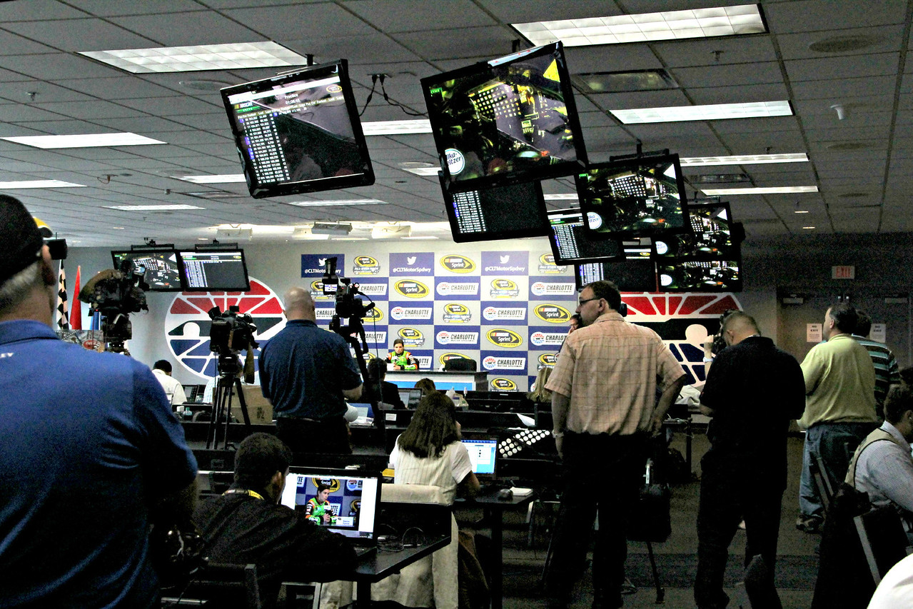 The press reports on the race while doing just what you do.....watching it on TV.....from the media room.