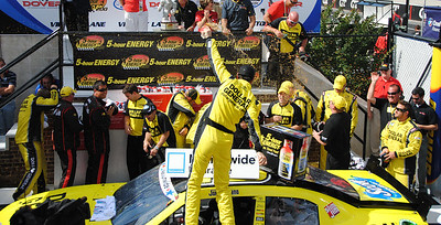 Joey Logano showers his team
