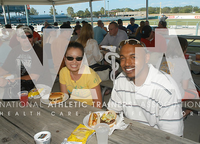 Dina Jones, left, ATC and Donald Sims, ATC, from Eastern Washington University, take in some food before Wednesday's baseball game. Photo by RenéŽe Fernandes/NATA.