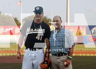 NATA Foundation President Mark Hoffman, PhD, ATC, poses with a San Antonio Missions player. Photo by Renée Fernandes/NATA.
