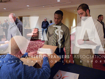 Athletic trainers and athletic training students check in at the hotel and get their materials for Capitol Hill Day 2010. Photo by Jordan Bostic/NATA