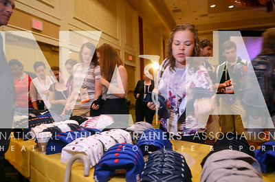 Students pick a hat from a table filled with them as they enter the scholarship breakfast during the annual convention. photo by Renée Fernandes