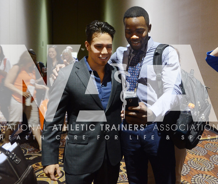credit: Renée Fernandes Apolo Antone Ohno poses with Brandon Esianor, a student from Arlington, TX, for a quick photo following his talk on Tuesday.