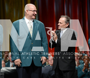 credit: Renée Fernandes Hall of Fame inductee Ralph Reiff, MED, ATC, LAT is applauded after putting on his green jacket during the ceremony,