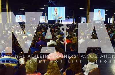 credit: Renée Fernandes Merril Hoge, former NFL player and a current ESPN analyst, talks to the crowd of almost 10,000 people about his training during the J&J Keynote Address.