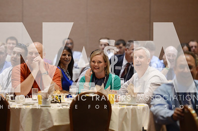 credit: Renée Fernandes Attendees react to the video of Michael Goldenberg's jump from the Stratosphere to raise money for NATAPAC during the breakfast Tuesday morning.