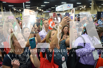 credit: Renée Fernandes Attendees strain to get photos of Robert Griffin III at the Hydroworx booth inside the Trade Show.