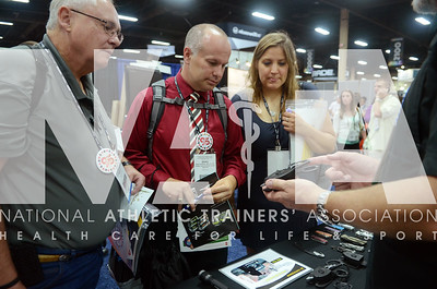 credit: Renée Fernandes Dennis Murphy, MS, ATC, LAT, left; Brad Morgan, MeD, AT, ATC; and Sarah Keller, ATC, LMT take a close look at a Leatherman during the opening day of the trade show.