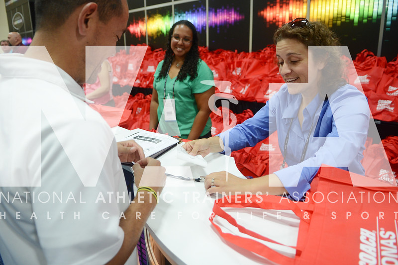 credit: Renée Fernandes Jennifer Dompier, MEd, ATC, helps William Garcia, MS, ATC with his registration materials at the beginning of the meeting.