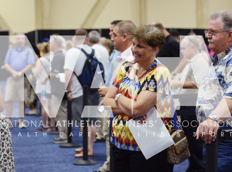credit: Renée Fernandes Cathy Supak, ATC, LAT waits her turn in line at registration on Monday.