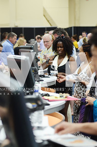 credit: Renée Fernandes Chelise Strickland, ATC, LAT gets her badge during registration on Monday.