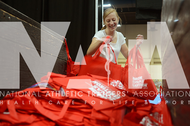 credit: Renée Fernandes Jenna Levy, MS, ATC, LAT, helps to prepare the registration bags before the start of the meeting.