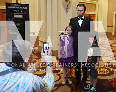 credit: Renée Fernandes Beth Freedman, MS, ATC, has her children, Miranda, 10 and Sammy, 8, pose with Abe Lincoln before going into the Opening Day Reception.