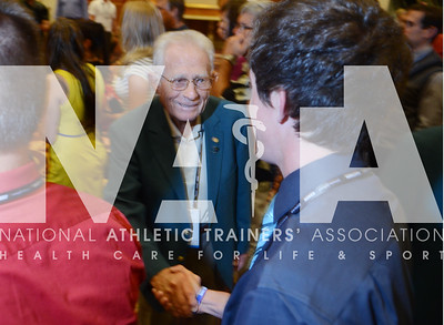 credit: Renée Fernandes Hall of Famer James Wilson, ATC, LAT, welcomes people to the opening night reception Tuesday.