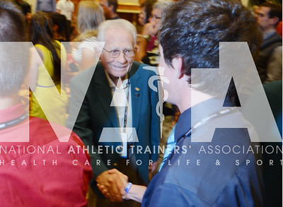 credit: Renée Fernandes Hall of Famer James Wilson, ATC, LAT, welcomes people to the Opening Day Reception Tuesday.