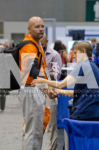Renee Fernandes/NATA Jason Weddle, ED, ATC, LAT tries on a UCL pitcher's brace during the AT Expo.