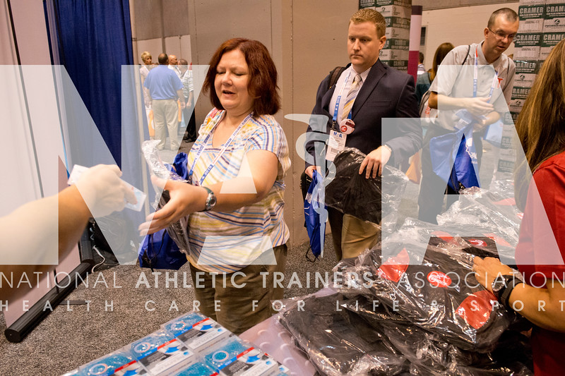 Renee Fernandes/NATA Melissa Koonce, MS, ATC grabs product in the Cramer booth.