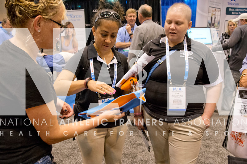 Renee Fernandes/NATA<br /> Theodora Scott, MS, ATC left and Erin Dowd, ATC, take a close look at the equipment with Sindi Scheinberg of Sam Medical during the AT Expo.