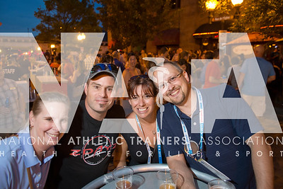 Renee Fernandes/NATA Michelle Settle, DPT, ATC, left;  Bryan Settle, Kathleen Fleck ,MED, ATC and Landon Lalonde, ATC have fun at the NATA Foundation Block Party at Laclede's Landing.